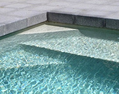 raven grey granite drop face pool coping tiles and pavers, black pool coping tiles, dark pool coping tiles by stone pavers melbourne sydney brisbane ,canberra adelaide