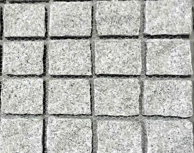Dove White natural split cobblestone tiles and pavers