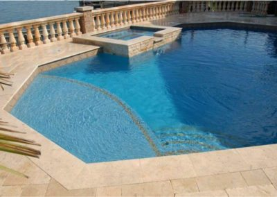 travertine pavers around a swimming pool