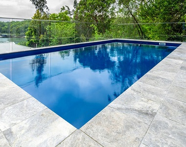silver travertine bullnose pool coping, silver pool coping tiles, round edge pool coping, stone pavers brisbane