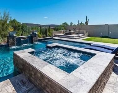 Silver Travertine Tiles around a pool